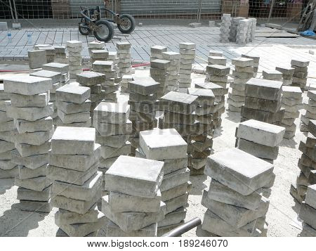 Square paving stones stacked for laying in village street in Andalusia