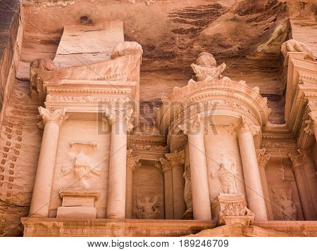 Front view of facade of Al-Khazneh temple - The Treasury - in Arab Nabatean Kingdom city of Petra Jordan