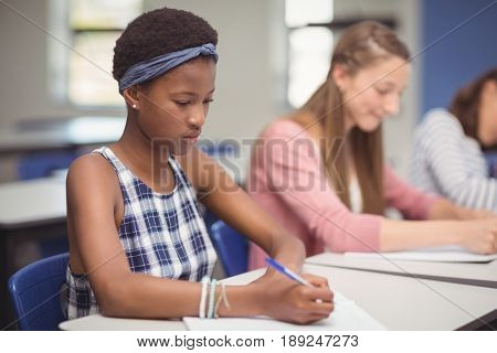 Students studying in classroom at school