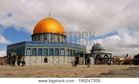 Jerusalem - May 24, 2017: Tourists at the Dome of the Rock in Jerusalem on the top of the Temple Mount. Golden Dome is the most known mosque and landmark in Jerusalem.