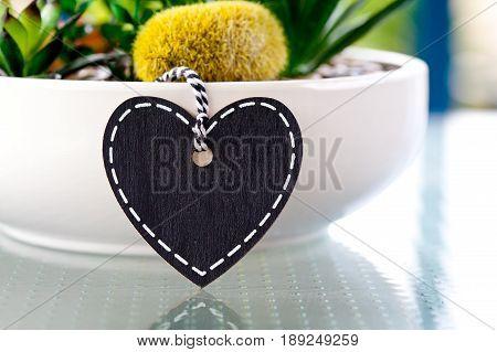Heart Blackboard on planter on glass table