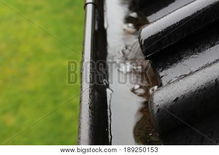 An image of a drain with raindrops