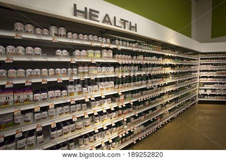 TORONTO, CANADA. December 28, 2014: Shop shelves with pharmaceutical products inside a new store (Shopper Drug Mart) in Toronto in Canada. Racks with vitamins and natural health products.
