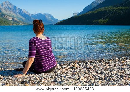 Young Lady Relaxing At The Beautiful Lake Waterton