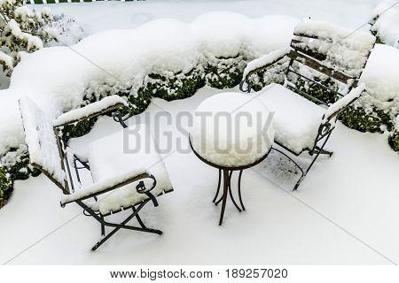 snowy garden furniture