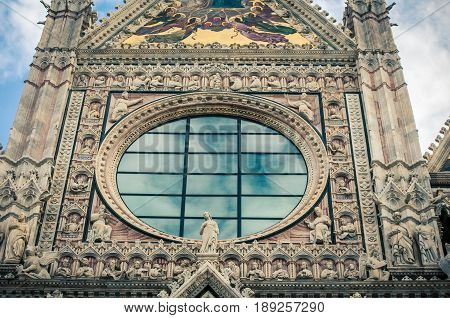 Window and façade of a church in siena italy