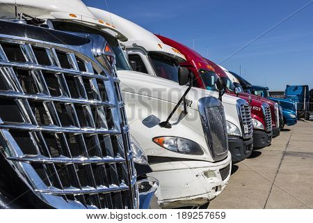 Indianapolis - Circa June 2017: Colorful Semi Tractor Trailer Trucks Lined up for Sale XIII