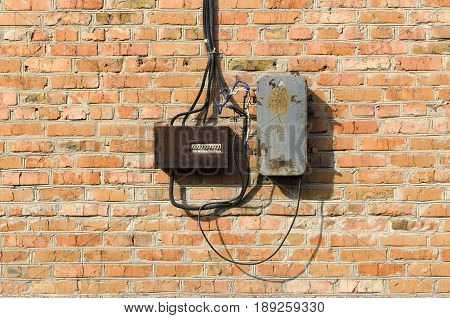Old electric box on brick wall. Electric equipment