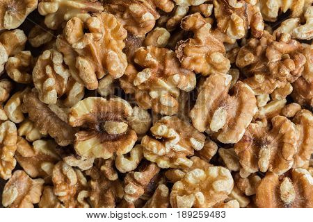 Baked walnuts for snack and bakery. Walnuts is good for health diet food raw material or ingredients for cooking and food.Natural tone macro concept for background.