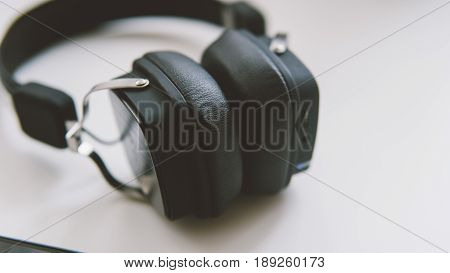 Wireless Headphones Are Black For The Music Fan Of The Clown-up. External Headphones Lying On A Whit