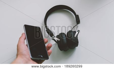 Musical Earphones With A Phone Close-up. Meloman And Quality Sound.