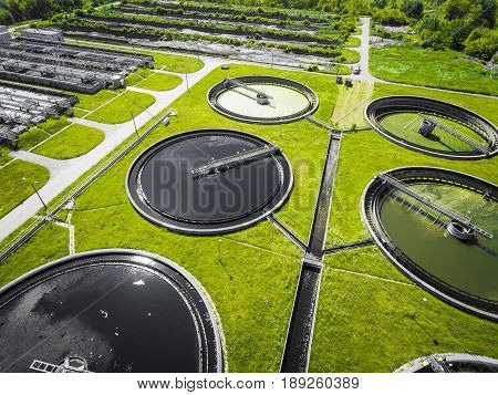 Sewage Farm. Static Aerial Photo Looking Down Onto The Clarifying Tanks And Green Grass. Geometric B