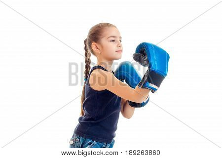 little girl with a pigtail in boxing gloves is isolated on a white background close-up