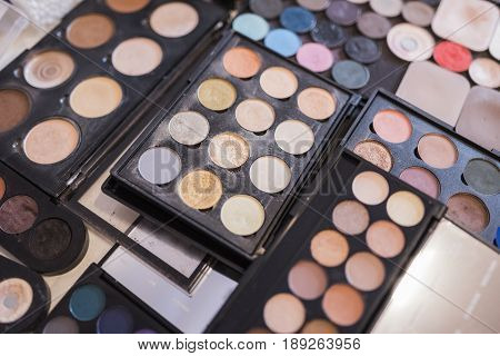 A pallet of concealer powder and shadows of light beige shades for professional make-up.