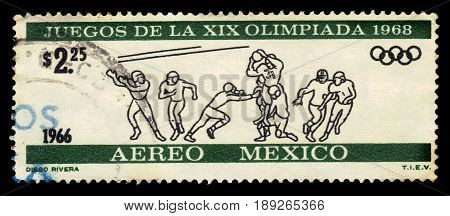Mexico - CIRCA 1966: a stamp printed by Mexico shows players in rugby. devoted to Olympic Games in Mexico in 1968, circa 1966