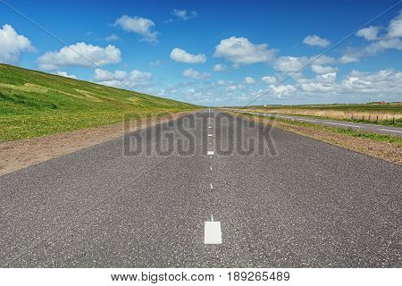 The road along The Hondsbossche Zeewering which is a 5.5 km long dike near Petten protecting The Netherlands against the North Sea