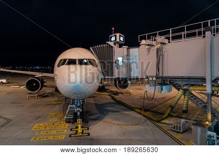Jet and Walkway at Night during a turnover between flights