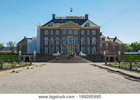 Apeldoorn, The Netherlands, May 8, 2016: Dutch baroque garden of The Loo Palace a former royal palace and now a national museum located in the outskirts of Apeldoorn in the Netherlands