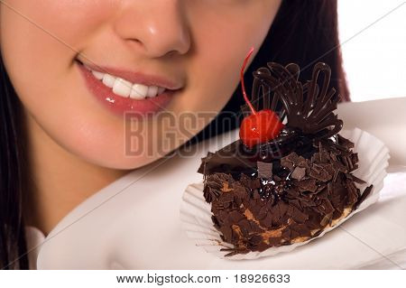 young girl with chocolate cake (isolated on white)