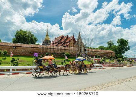 The horse carriage in Lampang at Wat Phra That Lampang Luang Lampang province in Thailand.