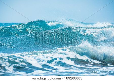 Waves barrel crashing and clear water. Blue wave in tropical sea.