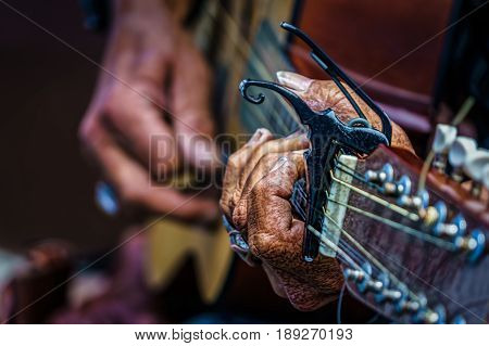 The rough hands of a street musician in southern California.