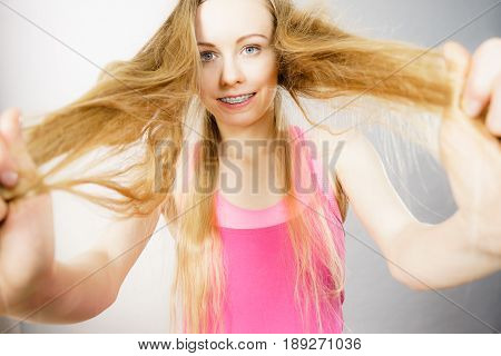 Young Woman Touching Her Long Hair