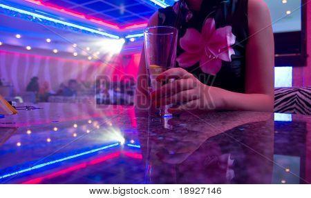 Young beautiful woman in the nightclub