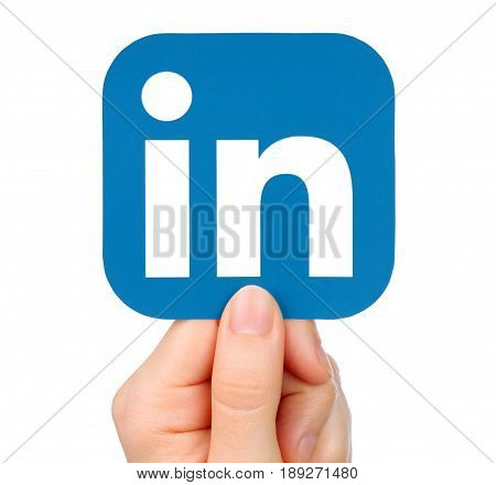 Kiev Ukraine - January 20 2016: Hand holds LinkedIn icon printed on paper. LinkedIn is a well-known social networking service