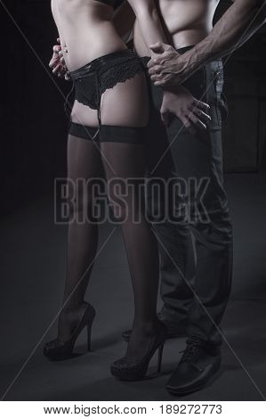 Sexy young couple body at night strong man grab woman