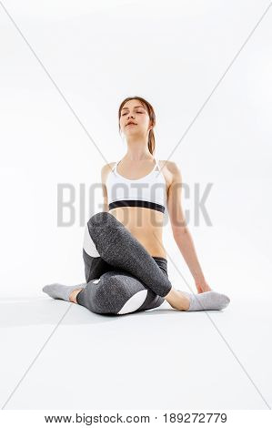 Sporty girl in training on white background