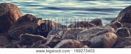 Gravel, sand and smaller boulders by the beach