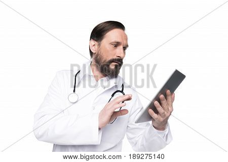 Caucasian Bearded Doctor In White Coat With Stethoscope Using Digital Tablet Isolated On White