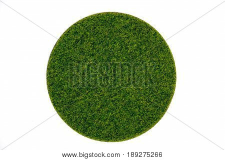 Artificial round green turf moss plate on white background