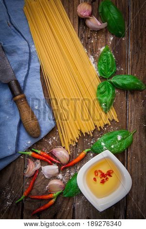 raw italian pasta on wooden board with japanese mushroom shiitake
