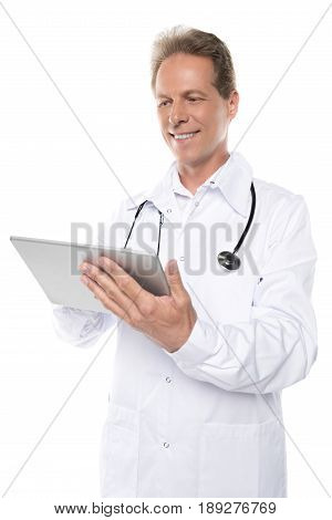 Smiling Middle Aged Doctor In White Coat Using Digital Tablet Isolated On White