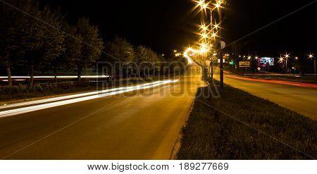 Transport metropolis, traffic and blurry lights of cars on multi-lane highways