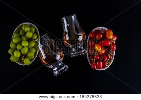 Single Malt Tasting Glasses, Single Malt Whisky In A Glass, White And Red Grapes In White Bowls