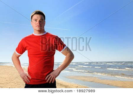 Young man standing at beach