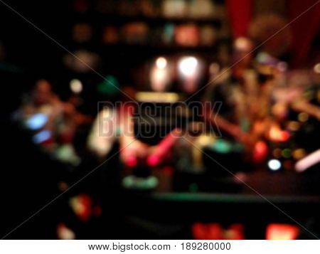 Blurred musicians playing jazz music at the pub