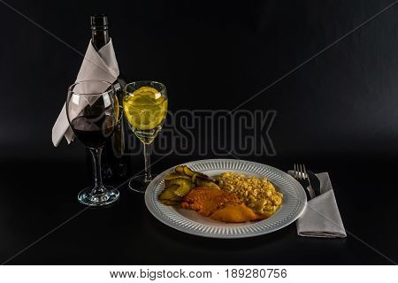 Chicken Breast With White Rice And Canned Cucumber, Water With Lemon And Red Wine, White Plate And B