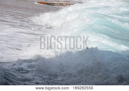 turbulent sea waves on a sandy beach