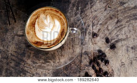 Hot cappuccino or latte art coffee. Morning breakfast with coffee. Latte art created by pouring steamed milk.