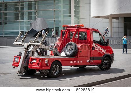 BARCELONA, SPAIN - MAY 2017: Red rescue wrecker car at street of Barcelona town, Spain.
