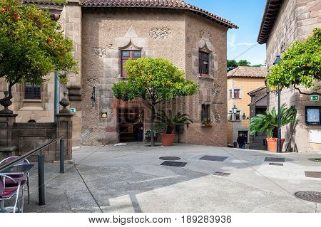 BARCELONA, SPAIN - MAY 2017: Inner yard of traditional Spanish village (Poble Espanyol) with cafes and gift shops.