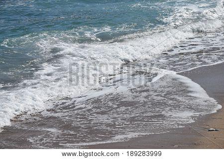 morsti turbulent waves on a sandy beach