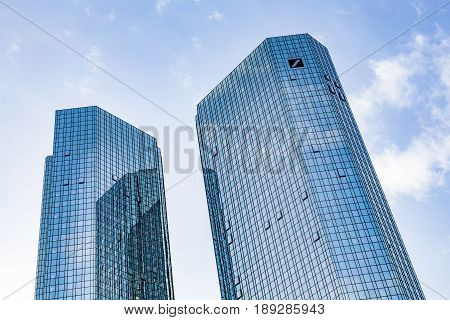 View To Skryscraper Of German Bank Downtown Frankfurt In Midday With Logo