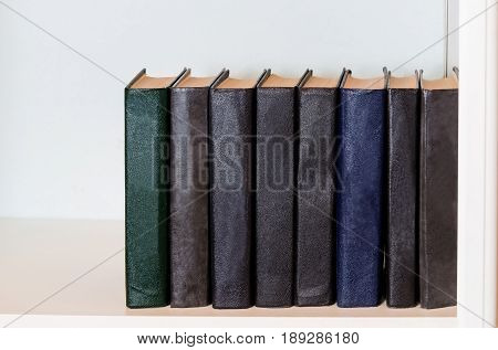 Black books on the shelf  in the bookcase