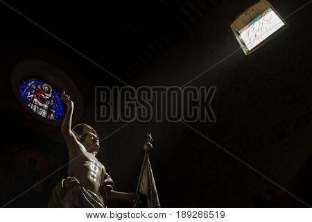 Statue of Jesus illuminated by a ray of light
