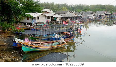 Fishing villages across the river Fishing villages extends along the river of Hat Narathat with the bay full of Korlae fishing boats.